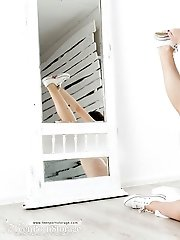 This Finely Shaped Brunette Lets All Her Clothes Slip And Sits On The Floor As She Is Showing Off Th