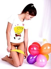 Lovely Teenage Cutie Plays With Balloons And Gets Nude Revealing Her Totally Unshaven Twat.