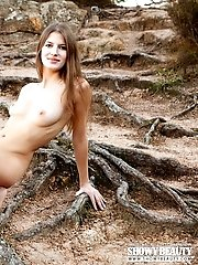 Beautiful Teen Cutie Spreading Legs And Showing Her Tempting Body On The Roots Of Big Tree.