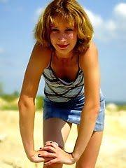 Horny Blonde Stripper At A Sandy Beach
