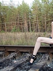 Cute Chick Strips Down On The Railway And Bends Over Exposing Her Tight Ass And Neat Pussy.