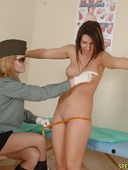 Lady doctor inspects a shivery military gal
