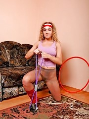 Blonde Iva in pantyhose working out with stretching expander