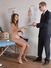 Two gynies exam a scared nude wench