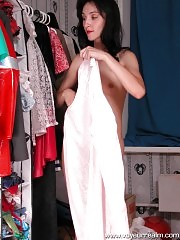 Nude skinny puss gets changed in wardrobe