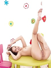 Super slim brunette girlfriend shows her best assets while posing in playroom. Eye catching beauty with full insight in her beauty.