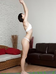 Short-cut nude girl stretching in the morning