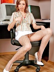 Secretary Angie posing in white fishnet pantyhose