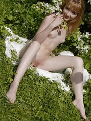 Stunning teenie enjoys every second while posing naked in the garden in front of the camera.