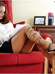 Brunette in pantyhose reading papers