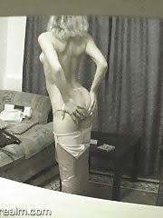 Slim blonde changing her dress