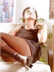 Smoking brunette in brown pantyhose
