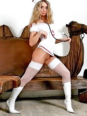 Blonde nurse Sielle in white stockings shows nice ass