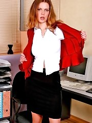 Redhead secretary Kelly showing nice tits and round ass