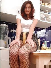 Sweet in fishnet pantyhose with banana