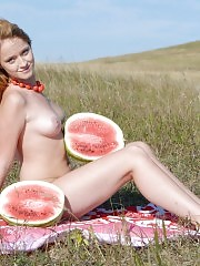 Adorable cutie enjoys her picnic with watermelon and shows off her perfect tits and pussy.