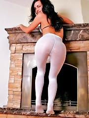 Gorgeous brunette Karolina showing her white pantyhose