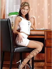Brunette in pantyhose posing on table