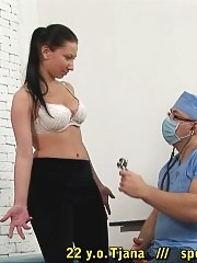 Brunette lets a doctor palpate and stretch everything