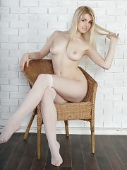 Sensual blonde with perfect tits and ass playfully poses in the nude showing off her pussy.