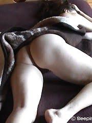 Brunette middle-aged woman filmed in nude sleep