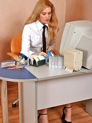 Blonde secretary Stella in stockings stripping and playing with her pussy at office
