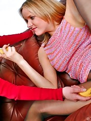 Couple of lesbians in pantyhose playing with bananas on sofa