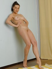 Stretching and undressing flexible dancer with big tits