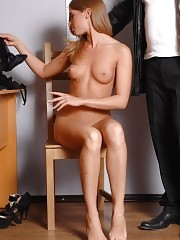 Undressed business girl poses obediently