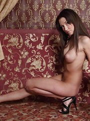 Long haired busty babe like to pose in front of the fireplace for camera because she knows that her body is cherished.