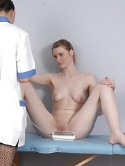 Lesbian gyno doc flirts with her nude examinee