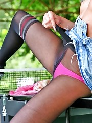 Blonde Evelin posing in fashion pantyhose on the tennis table