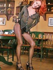 Long legs, black pantyhose and exotic platforms