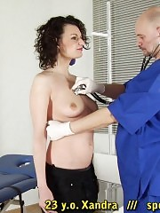 Fetish vaginal exam of a gagged curly girl