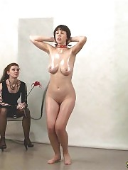 Nude special exercising of a collared bombshell