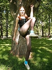 Redhead Babette doing pantyhose aerobics outdoors