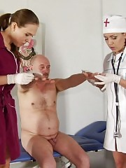 Dressed nurses examine an embarrassed nude dude
