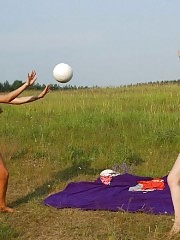 Two hot naked chicks playing volleyball