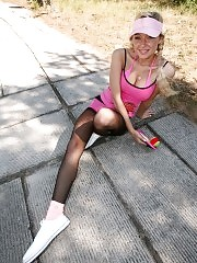 Blonde girl in pantyhose with sticky paddle