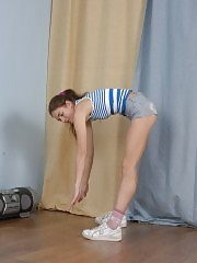 Jumping and stretching naked sports wench