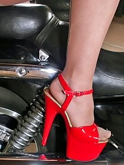 Hot readhead in pantyhose and red high heels