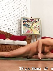 Flexible blondie stretching nude on the floor