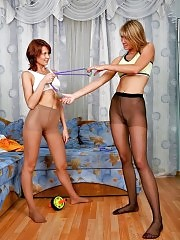 Two gymnasts in pantyhose do home workouts
