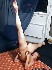 Seductive redhead shows nude gymnastic tricks
