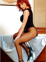 Busty redhead Jane posing in fashion pantyhose at home