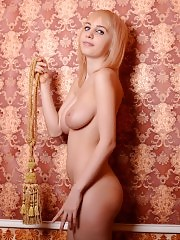 Blonde beauty with big tits shows herself in a great scene where she gets naked and lustful by herself on set.