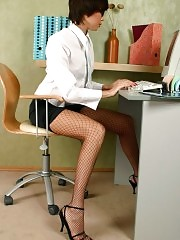 Young secretary in hot fishnet stockings