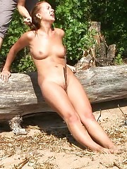 Sport nude slave balancing on a broken tree