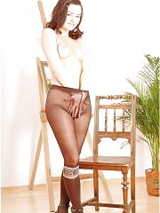 Nikol in pantyhose posing on chair