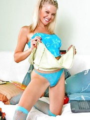 Jolly blondie blazons out her blue panties
